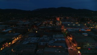 DX0002_132_014 - 5.7K stock footage aerial video of the cathedral lit up at night at the end of San Francisco Street, Santa Fe, New Mexico