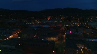 DX0002_132_017 - 5.7K stock footage aerial video flyby downtown, reveal San Francisco Street leading to cathedral at night, Santa Fe, New Mexico