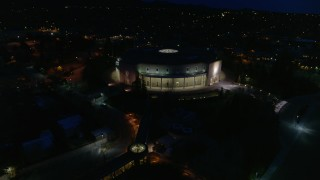 DX0002_132_023 - 5.7K stock footage aerial video of slowly orbiting the New Mexico State Capitol at night, Santa Fe, New Mexico