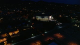 DX0002_132_024 - 5.7K stock footage aerial video of a reverse view of the New Mexico State Capitol at night, Santa Fe, New Mexico
