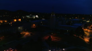DX0002_132_025 - 5.7K stock footage aerial video reverse view of Bataan Memorial Building and New Mexico State Capitol at night, Santa Fe, New Mexico