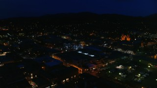DX0002_132_026 - 5.7K stock footage aerial video orbit Santa Fe Plaza near the cathedral at night, Santa Fe, New Mexico