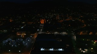DX0002_132_033 - 5.7K stock footage aerial video reverse view of the cathedral and Santa Fe Plaza at night, Santa Fe, New Mexico