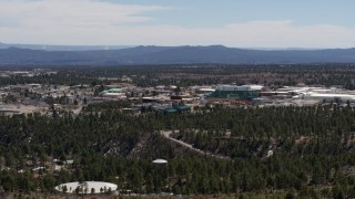 DX0002_133_023 - 5.7K stock footage aerial video ascend while slowly passing Los Alamos National Laboratory, New Mexico