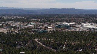 DX0002_133_024 - 5.7K stock footage aerial video of flying by Los Alamos National Laboratory, New Mexico