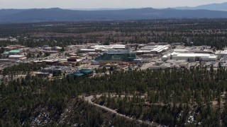 DX0002_133_027 - 5.7K stock footage aerial video of slowly passing the Los Alamos National Laboratory, New Mexico