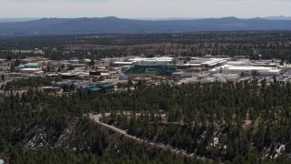 DX0002_133_028 - 5.7K stock footage aerial video wide view of the Los Alamos National Laboratory during descent, New Mexico