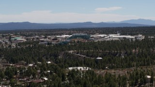 DX0002_133_029 - 5.7K stock footage aerial video wide reverse view of the Los Alamos National Laboratory, New Mexico