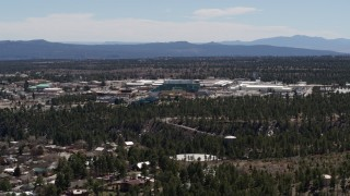 DX0002_133_030 - 5.7K stock footage aerial video wide view of the Los Alamos National Laboratory during ascent, New Mexico