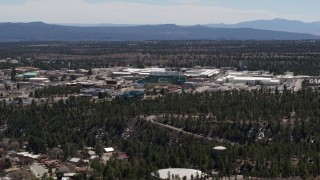 DX0002_133_031 - 5.7K stock footage aerial video wide stationary view and approach to the Los Alamos National Laboratory, New Mexico