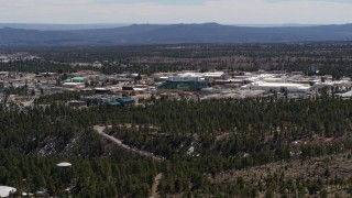 DX0002_133_035 - 5.7K stock footage aerial video of slowly flying by the Los Alamos National Laboratory complex, New Mexico