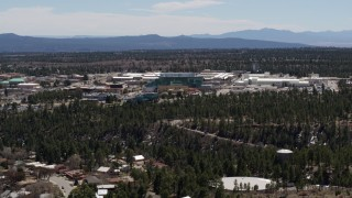 DX0002_133_036 - 5.7K stock footage aerial video of slowly passing by the Los Alamos National Laboratory complex, New Mexico