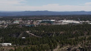 DX0002_133_038 - 5.7K stock footage aerial video ascend while flying by the Los Alamos National Laboratory complex, New Mexico