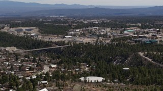 DX0002_133_039 - 5.7K stock footage aerial video a bridge spanning the canyon to the Los Alamos National Laboratory complex, New Mexico