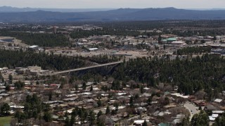 DX0002_133_040 - 5.7K stock footage aerial video of a bridge spanning the canyon to the Los Alamos National Laboratory complex, New Mexico