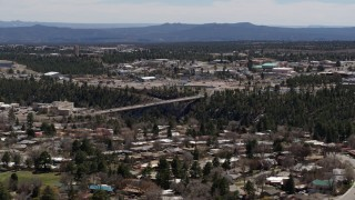 DX0002_133_041 - 5.7K stock footage aerial video cars crossing bridge spanning the canyon to the Los Alamos National Laboratory, New Mexico