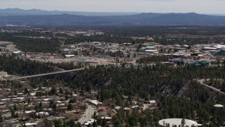 DX0002_133_042 - 5.7K stock footage aerial video of a bridge across a canyon and the Los Alamos National Laboratory, New Mexico