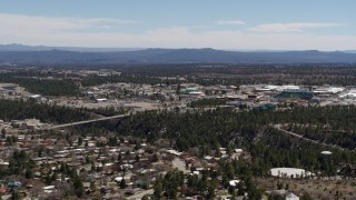 DX0002_134_003 - 5.7K stock footage aerial video approach bridge across a canyon and the Los Alamos National Laboratory, New Mexico
