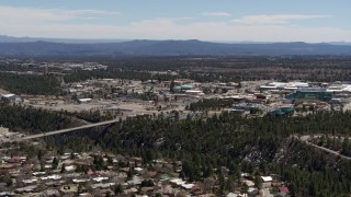 DX0002_134_004 - 5.7K stock footage aerial video slow approach to bridge across a canyon and the Los Alamos National Laboratory, New Mexico