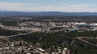 DX0002_134_005 - 5.7K stock footage aerial video ascend and fly away from bridge across canyon and Los Alamos National Laboratory, New Mexico