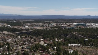 DX0002_134_006 - 5.7K stock footage aerial video of bridge across canyon and Los Alamos National Laboratory during descent, New Mexico