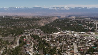 DX0002_134_009 - 5.7K stock footage aerial video distant mountains seen from neighborhoods near mesas and canyons in Los Alamos, New Mexico
