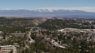 DX0002_134_011 - 5.7K stock footage aerial video distant mountains while flying past homes near mesas and canyons in Los Alamos, New Mexico