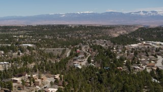 DX0002_134_013 - 5.7K stock footage aerial video of homes and mesas with a view of mountains in Los Alamos, New Mexico