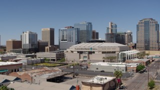 DX0002_136_001 - 5.7K stock footage aerial video of passing the arena near office buildings in Downtown Phoenix, Arizona