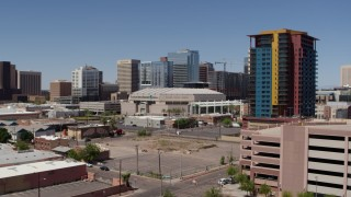 DX0002_136_004 - 5.7K stock footage aerial video of orbiting the arena near condo complex in Downtown Phoenix, Arizona