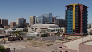 DX0002_136_005 - 5.7K stock footage aerial video of flying by the arena to reveal condo complex in Downtown Phoenix, Arizona