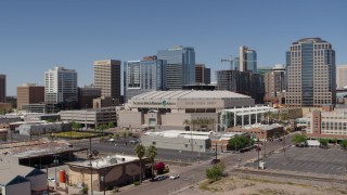 DX0002_136_010 - 5.7K stock footage aerial video of flying by condo complex to focus on the arena in Downtown Phoenix, Arizona