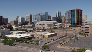 DX0002_136_012 - 5.7K stock footage aerial video of slowly flying past from the arena and office buildings, reveal condo complex in Downtown Phoenix, Arizona