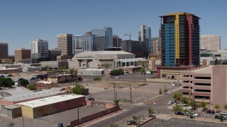 DX0002_136_013 - 5.7K stock footage aerial video of a slow approach to the arena past the condo complex in Downtown Phoenix, Arizona