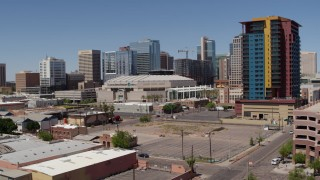 DX0002_136_015 - 5.7K stock footage aerial video of a slow pass by the arena and reveal the condo complex in Downtown Phoenix, Arizona