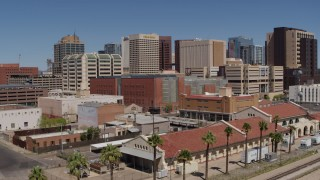 DX0002_136_022 - 5.7K stock footage aerial video of flying toward a train station and the city skyline of Downtown Phoenix, Arizona