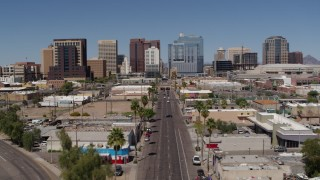 DX0002_136_031 - 5.7K stock footage aerial video flyby Central Avenue with a view of tall office buildings, Downtown Phoenix, Arizona