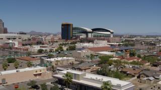 DX0002_136_038 - 5.7K stock footage aerial video of condominium complex and baseball stadium, Downtown Phoenix, Arizona
