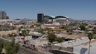 DX0002_136_039 - 5.7K stock footage aerial video of condominium complex and baseball stadium seen during decent, Downtown Phoenix, Arizona