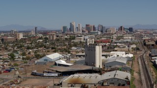 DX0002_136_048 - 5.7K stock footage aerial video of a wide view of the city's skyline, reveal grain elevator in Downtown Phoenix, Arizona