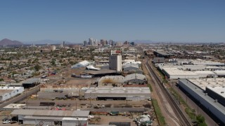 DX0002_137_006 - 5.7K stock footage aerial video of a wide view of the city's skyline, urban homes, grain elevator and rail in Downtown Phoenix, Arizona