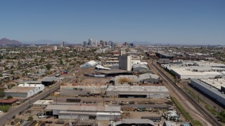 DX0002_137_007 - 5.7K stock footage aerial video train tracks, grain elevator, and city skyline in Downtown Phoenix, Arizona