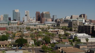DX0002_137_032 - 5.7K stock footage aerial video slowly flying past high-rise office buildings in Downtown Phoenix, Arizona