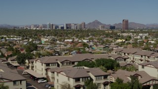 DX0002_137_042 - 5.7K stock footage aerial video a view of tall office buildings seen from city park and apartment buildings in Phoenix, Arizona