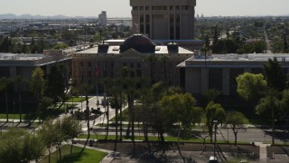 DX0002_137_058 - 5.7K stock footage aerial video of circling the front of Arizona State Capitol building in Phoenix, Arizona