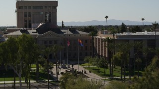 DX0002_137_062 - 5.7K stock footage aerial video of ascending from trees, reveal the Arizona State Capitol building in Phoenix, Arizona