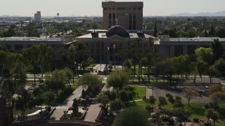 DX0002_137_065 - 5.7K stock footage aerial video a reverse view and orbit of the Arizona State Capitol building in Phoenix, Arizona