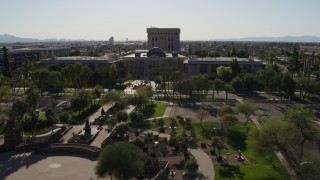DX0002_138_003 - 5.7K stock footage aerial video flyby plaza while focused the Arizona State Capitol building in Phoenix, Arizona