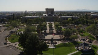 DX0002_138_005 - 5.7K stock footage aerial video reverse view of plaza and the Arizona State Capitol building in Phoenix, Arizona