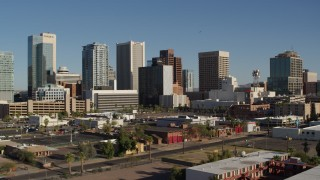 DX0002_138_008 - 5.7K stock footage aerial video flying by the city's high-rise office buildings in Downtown Phoenix, Arizona